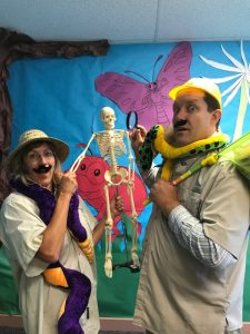 Dr. Brandon Yost principal, Darleene Tanner Learning coach both dressed as explorers