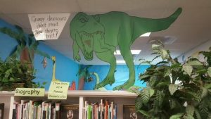 picture of dinosaur displayed in the library